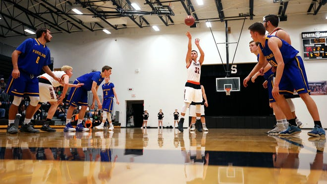 Guard Logan Thomazin (32) broke the Walnut Grove career scoring record, set in 1976 by Tim McPhail, after shooting this free throw during the team's Jan. 27 game against Sparta.