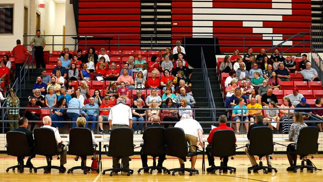 Members of the Reeds Spring School District School Board take their seats prior to a public meeting of the board held at Reeds Spring High School in Reeds Spring, Mo. on April 19, 2017. The meeting drew increased attendance due to recent sexual assault allegations levied against superintendent Michael Mason.