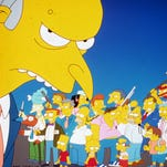 "Montgomery Burns, foreground, appears with other animated cast members in a scene from Fox Television's ""The Simpsons."""