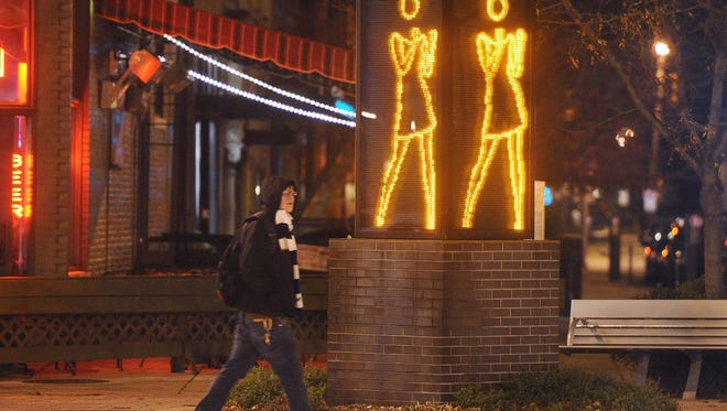 The Ann Dancing sign beckons you into Mass Ave., where the restaurants are similar to trendy restaurants in many other cities.
