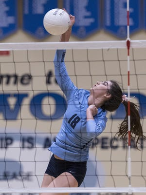 Redwood's Brooke Gilcrest hits against Hanford West in girls volleyball on Tuesday, October 11, 2016.