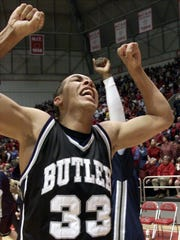 Butler's Joel Cornette celebrates his team's 75-66 win over Ball State in Muncie on Wednesday, Dec. 19, 2001.