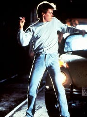 "Kevin Bacon in a scene from the 1984 film ""Footloose."""