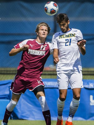 Delaware's Thibault Philippe, right,  goes for a header against Fordham's Eric Ohlendorf  in a UD win last season.