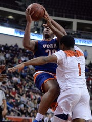 York High's Marquise McClean, left, goes up for a shot againsyt Northeastern during Monday's District 3 Class 5-A semifinal game at Hershey's Giant Center. John A. Pavoncello