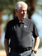 Former President Bill Clinton arrives at the Palmer Private Course at PGA West during the third round of the Humana Challenge on Saturday. Clinton will be present at the golf course Sunday to award the championship trophy.