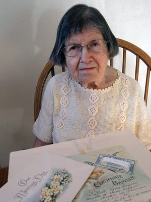 Ruthelle Frank sits in her home in Brokaw, Wis., with some of the documents that were not good enough to get her a state ID for voting in 2011. She challenged the  photo ID law in court.