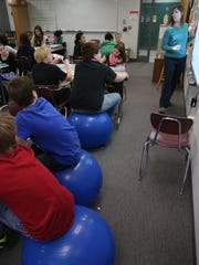 Students are seated on balls Friday at Horace Mann Middle School in Wausau. The balls are one of the devices used to keep students active during Amy Akey's seventh-grade math class.