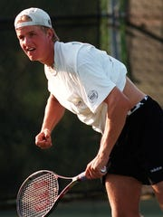 Former Okemos tennis standout Nathan Overholser, shown in a 1997 photo, is part of the school's latest Athletic Hall of Fame class.