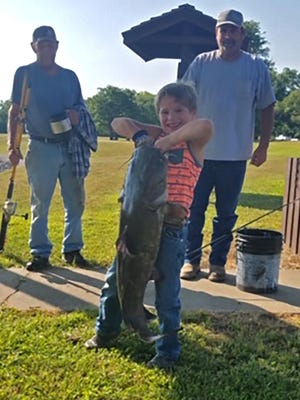 "Six-year-old Paxton Buchman, of Council Grove, loves fishing. He recently hooked into a nice 10-pound flathead catfish and also had a ""huge"" blue catfish break off his line."