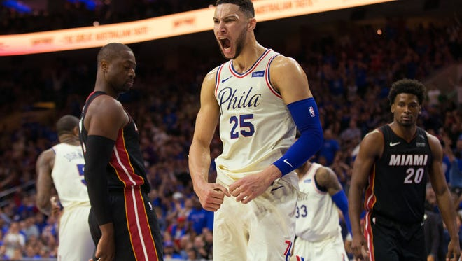 Philadelphia 76ers guard Ben Simmons (25) reacts in front of Miami Heat guard Dwyane Wade (3) and forward Justise Winslow (20) after hi dunk during the third quarter in game one of the first round of the 2018 NBA Playoffs at Wells Fargo Center.