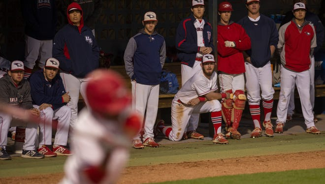 The Southern Indiana dugout watches teammate Buddy Johnson bat against Missouri-St. Louis at the USI Baseball Field Wednesday evening.