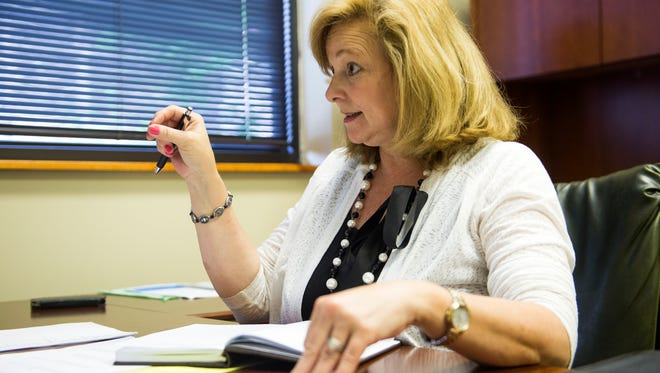 Janice Hendrix, recently named executive director at the nonprofit Mountain Tough, which is charged with helping Gatlinburg wildfire survivors recover, sits in her office off the Parkway in Gatlinburg on Thursday, May 18, 2017.