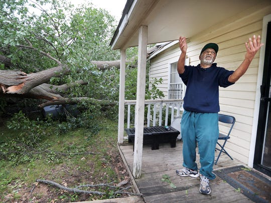 William Echols describes standing in his front door praying that the enormous tree swaying in his front yard would not fall on his Frayser home and kill him during a severe thunderstorm Saturday night that knocked out power to most of Memphis.