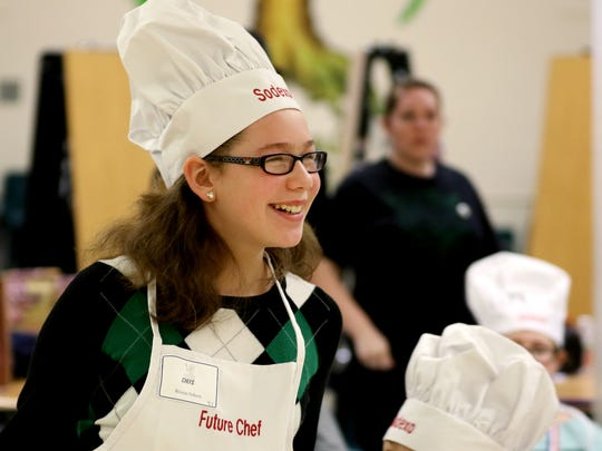 Brianna Saleen, a fifth-grader at Yoshikai Elementary School, smiles as she is awarded the judge's choice award during the Future Chef competition for fourth and fifth graders at McKay High School in Salem on Thursday, March 17, 2016. Each student submitted and prepared a recipe for a healthy breakfast.