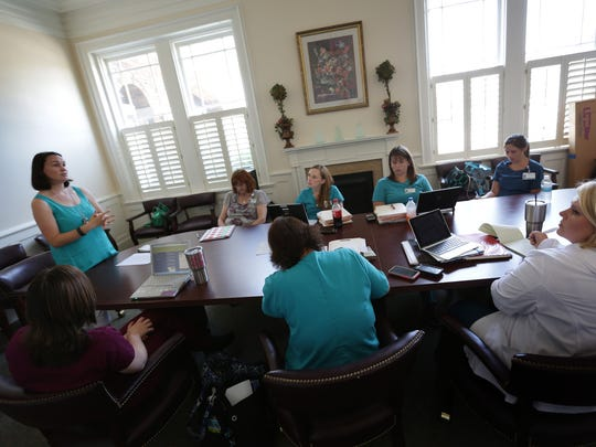 Nurses from the Nurse- Family Partnership have a conversation during a workshop on child abuse at their headquarters in Florence, SC in June 2016.