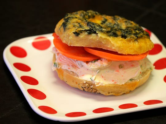 An Asiago spinach bagel with tomato and vegetable cream cheese is one of many breakfast options at Gem's Bagels..