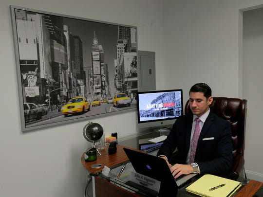 John A. Vagueiro, president of Adapting Social, works in his office in Red Bank.
