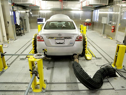 A vehicle is shown hooked up in the Cold Temperature Test Facility at the National Vehicle and Fuel Emissions Lab in Ann Arbor on Thursday October 9, 2014.