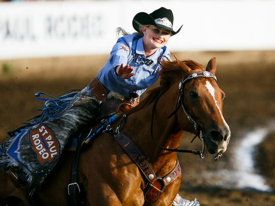 St. Paul Rodeo Princess Morgan Spear waves the crowd