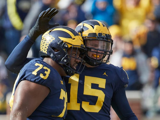 Michigan defensive lineman Maurice Hurst (73) receives congratulations from Chase Winovich after a sack against Rutgers in the first half at Michigan Stadium, Saturday, Oct. 28, 2017.