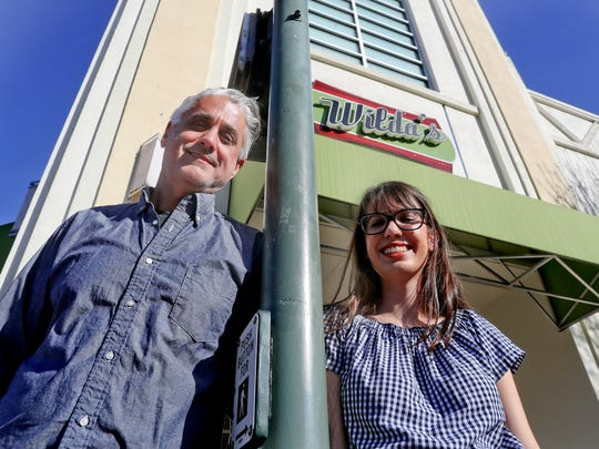 Bret Speers stands with his daughter, Iris, on Thursday at the new location of Wilda's, the restaurant the family owns.