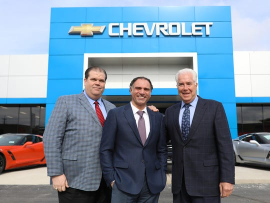 Ali Reda, center, takes a photo with General Sales Manager Scott Montgomery and dealer Gary Stanford of Les Stanford Chevrolet and Cadillac Inc., where Reda sold 1,582 new vehicles in 2017 at the dealership in Dearborn.