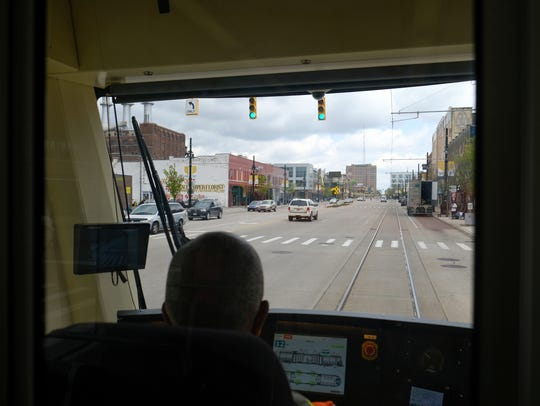 An operator drives the QLINE along Woodward Avenue