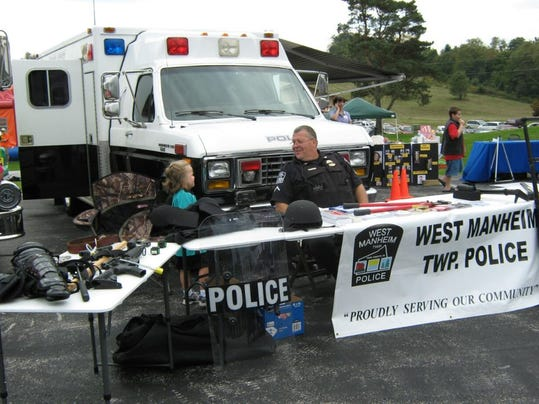 West Manheim Township Police set up a table to display items during the Harvest in the Valley celebration at Calvary Assembly of God. Photo Submitted.