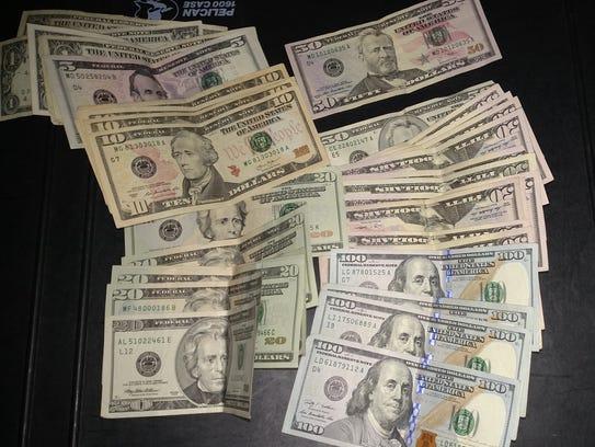 More than $1,600 was seized in a Thursday drug raid