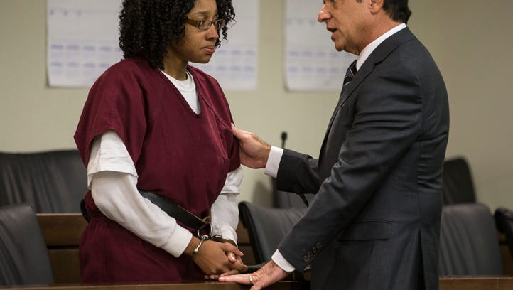 Moore talks with her attorney Michael Chazen. A bail