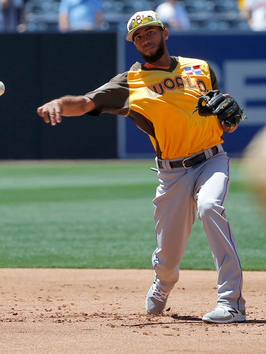 FILE - In this July 10, 2016, file photo, World Team's Amed Rosario, of the New York Mets, fields prior to the All-Star Futures baseball game against the U.S. Team in San Diego. The Mets are bringing up top shortstop prospect Rosario and say the 21-year-old will be in the starting lineup Tuesday, Aug. 1, 2017, at Colorado in his major league debut. (AP Photo/Lenny Ignelzi, File)