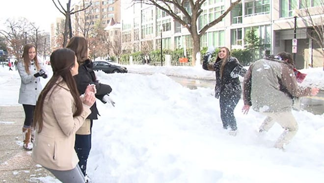 Students from Catholic schools in the Valley who have been trapped in Washington by Winter Storm Jonas take advantage of the storm's aftermath to let off some steam outside their hotel.