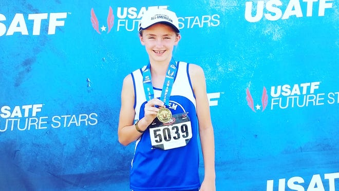 Cascade Middle School student Emma Gates won the national championship in the high jump with a mark of 5-1.