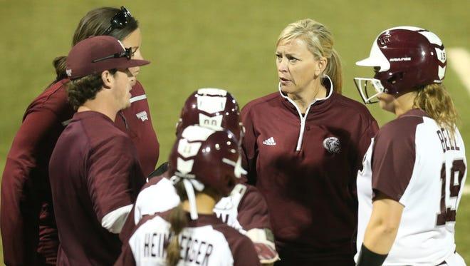 Vann Stuedeman talks with her Mississippi State softball team.