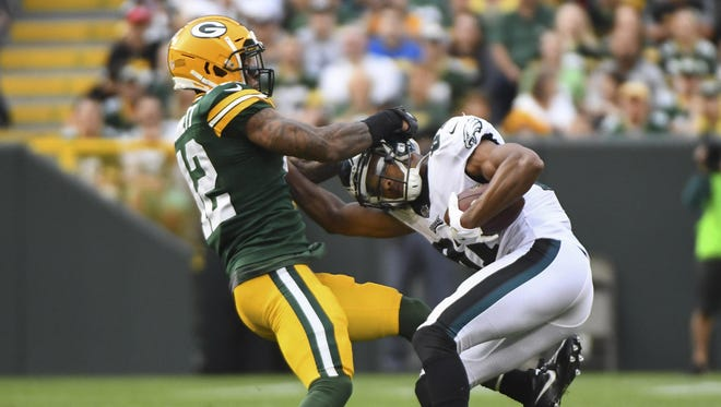 Packers safety Morgan Burnett tries bringing down Eagles receiver Torrey Smith after Smith's catch in their preseason game Aug. 10. Burnett is adding inside linebacker to his responsibilities in the team's 'Nitro' package.