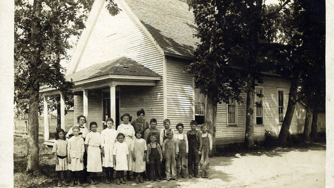 The student body at Pioneer School between Brooks and Gervais poses for a photo around 1915. The photo belonged to the late Opal Loron, who is pictured third from the left in the middle row. Pictured in the front row, from left to right, are: Opal Hubbard, Ethel Mendenhall, Ralph Jones and Francis Savage. Middle row: Mary Mendenhall, Alice Collard, Opal Loron, Mertie Mendenhall, Eva Mendenahall, Melvin Jones, Glen Savage, Willie Holt, Everett Jones and Walter Savage. Back row: Teacher Martha Denny and student Verda Holt.