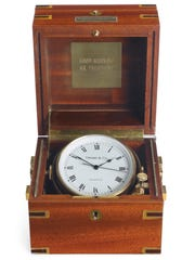 This undated photo provided by Christie's shows a marine chronometer given to Ronald Reagan by Frank Sinatra for Reagan's first inauguration.
