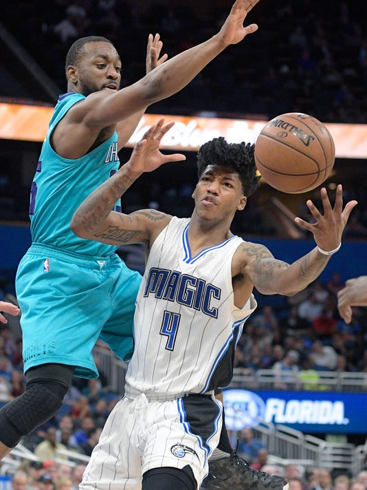 Charlotte Hornets guard Kemba Walker, left, forces Orlando Magic guard Elfrid Payton (4) to turn the ball over while Payton was driving to the basket during the second half of an NBA basketball game in Orlando, Fla., Wednesday, March 22, 2017. The Hornets won 109-102. (AP Photo/Phelan M. Ebenhack)