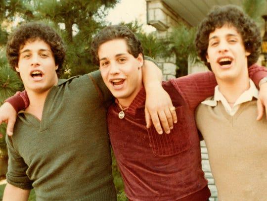 Triplets Eddy Galland (from left), David Kellman and