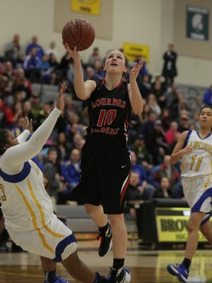 Oshkosh Lourdes Ellie DeGroot goes up for a shot during their game against Kenosha St. Josephs in the WIAA sectional final game March 5, 2016 held at Brown Deer High School. The Knights lost to the Lancers 58 - 55.