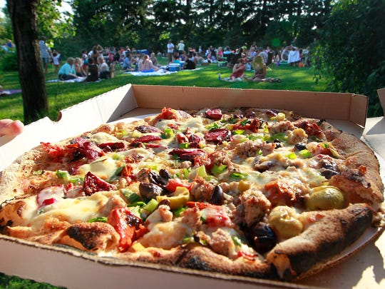 Pizza on the farm night at A to Z Produce and Bakery outside Stockholm draws visitors from miles around to enjoy brick-oven pizzas made from fresh ingredients.