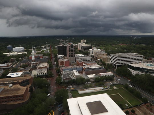 Dark grey clouds hover over downtown Tallahassee Tuesday as the city maintains its rain-soaked status after Subtropical Storm Alberto blew through town.