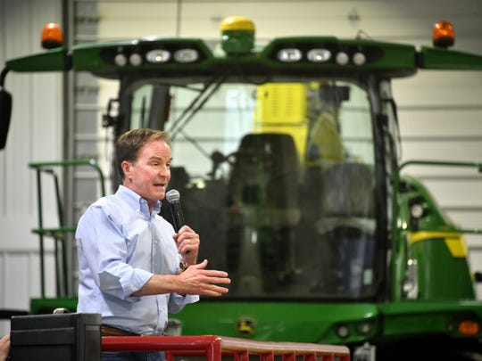 Republican gubernatorial hopeful Bill Schuette, currently the Michigan attorney general, stumps from the a farm wagon at an event on the Weir farm in Southern Michigan near Hanover.