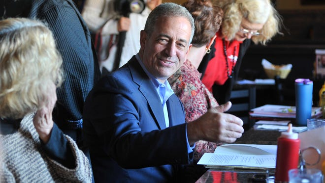 Former Sen. Russ Feingold visits a small group of senior citizens to discuss issues Thursday afternoon at Day's Bowl A Dome in Wausau.