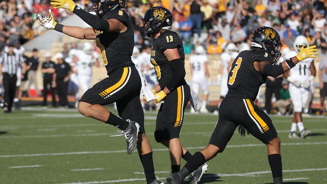 Fort Hays State University defensive backs Jordan Starks (8), Hayden Kreutzer (13), and Jhimon Preston (3) celebrate a fumble recovery against Northwest Missouri last season at Lewis Field Stadium in Hays.