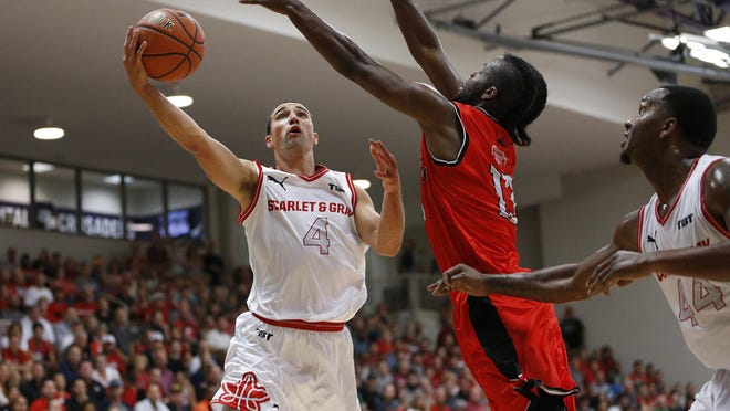 Scarlet & Gray's Aaron Craft (4) takes a shot around Matadorss Quincy Diggs (13) during The Basketball Tournament second-round game at Capital University in Columbus on July 22, 2018. Team Scarlet & Gray won 82-73.