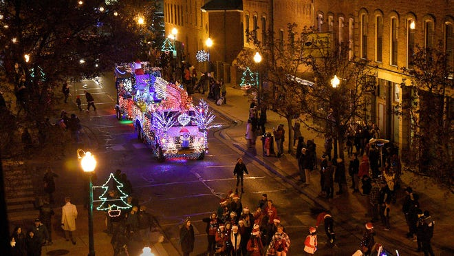 Christmas Magic in Monroe grand marshall Ralph Mahalak Jr. is followed by the DTE Holiday Lights Truck during the 2018 Christmas Magic in Monroe -- Parade and Winter Wonderland. This year's parade was canceled in light of the coronavirus pandemic.