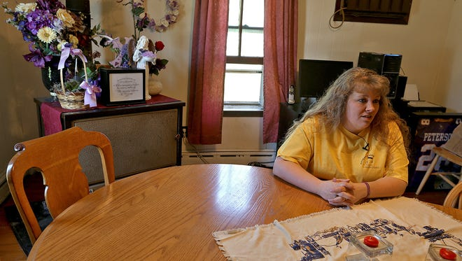 Denise Shepard reflects on how family members have not eaten a meal together at their dining room table since the kidnapping of her daughter Kathlynn one year ago. The family plans to dine at the table Tuesday, May 20, 2014.