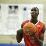 Orangeville Prep's Thon Maker #14 shoots a free throw against Phelps Academy during their Big Apple Basketball Classic high school basketball game in Manhattan, NY on Saturday, January 17,  2015.  (AP Photo/Gregory Payan)